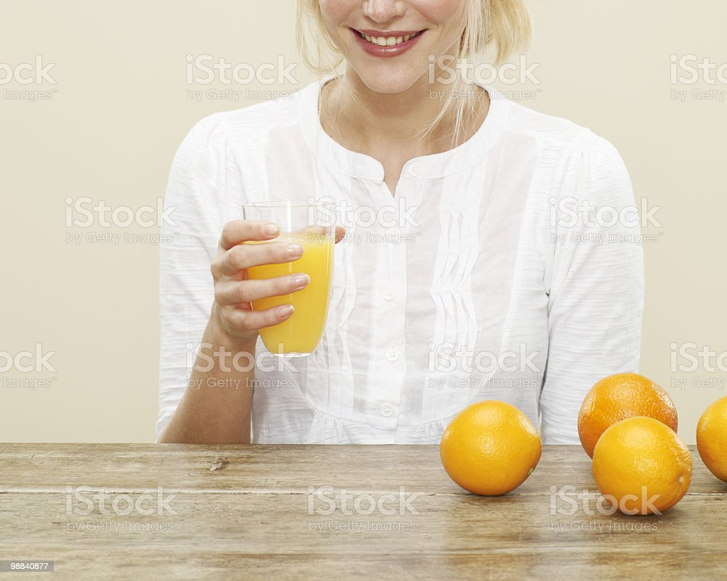 close up of female with glass of orange juice foto de stock royalty-free