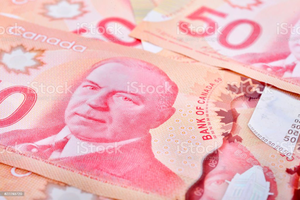 Close up of fifty Canadian banknotes (CAD) background stock photo