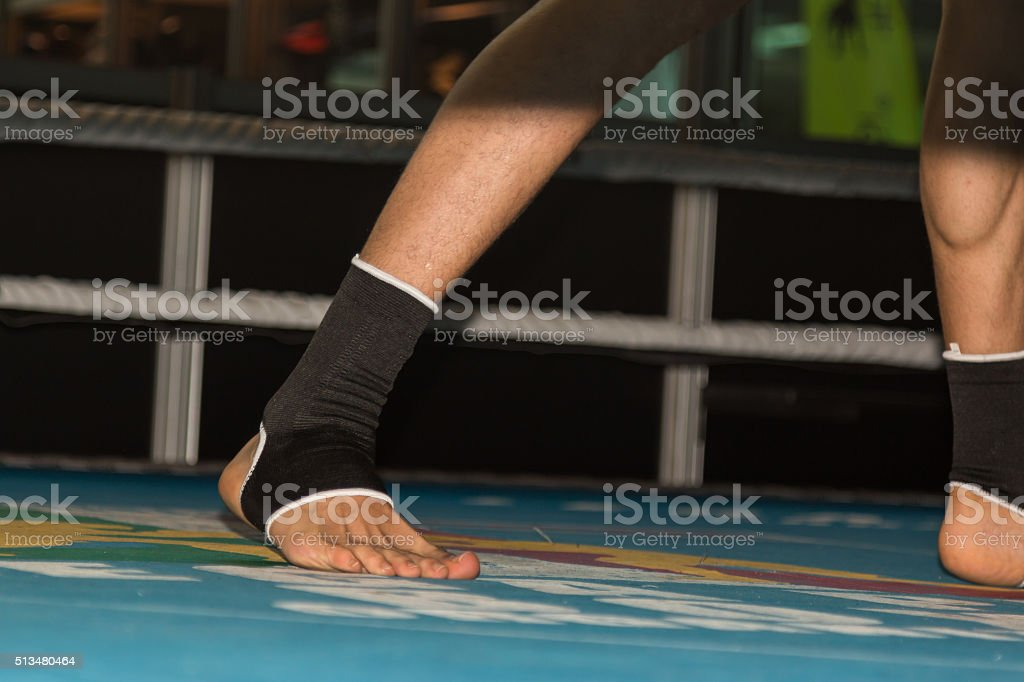 Close Up of Fighter's Foot with Ankle Brace Support stock photo