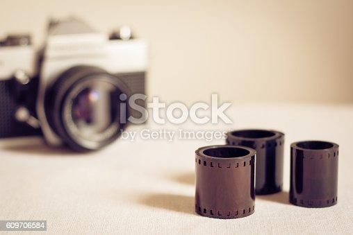 609706398 istock photo Close up of film rolls with retro photo camera 609706584