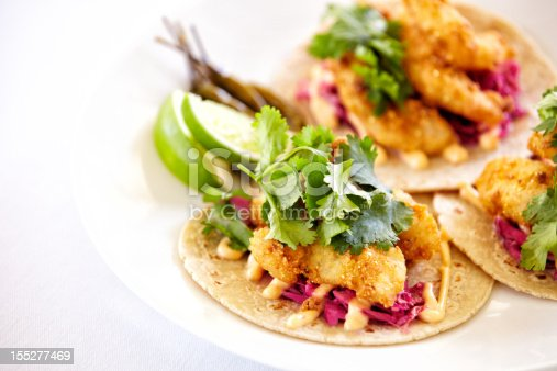 Close up of fish tacos on a plate.  Horizontal shot.