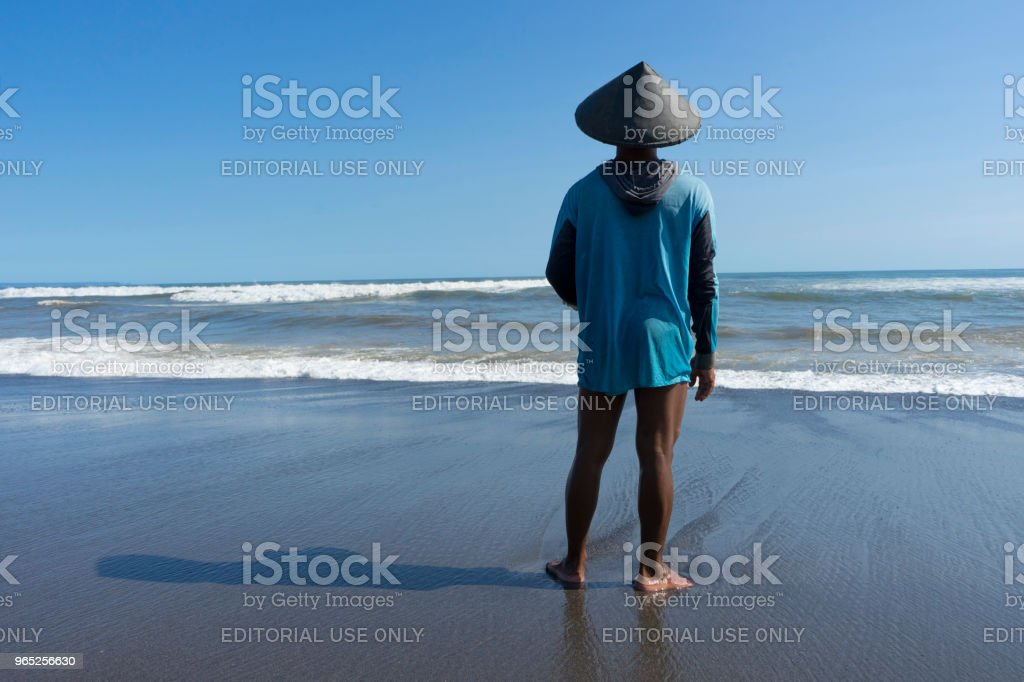 close up of fisherman standing on the beach in Bali,Indonesia royalty-free stock photo