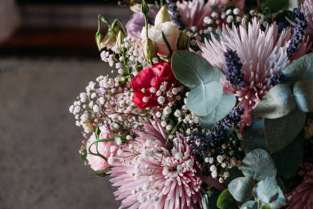close up of flowers bouquet indoors with natural light and moody mood stock photo
