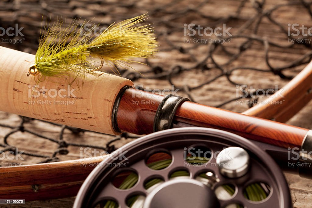Close  up of Fly-Fishing Equipment & tackle on weathered wood. stock photo