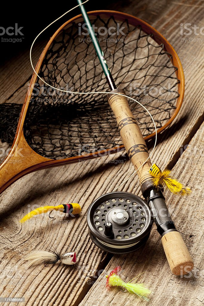 Close up of Fly-Fishing equipment on wood Background. royalty-free stock photo