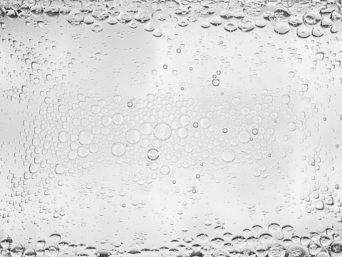 Close up of foam bubbles in water background.