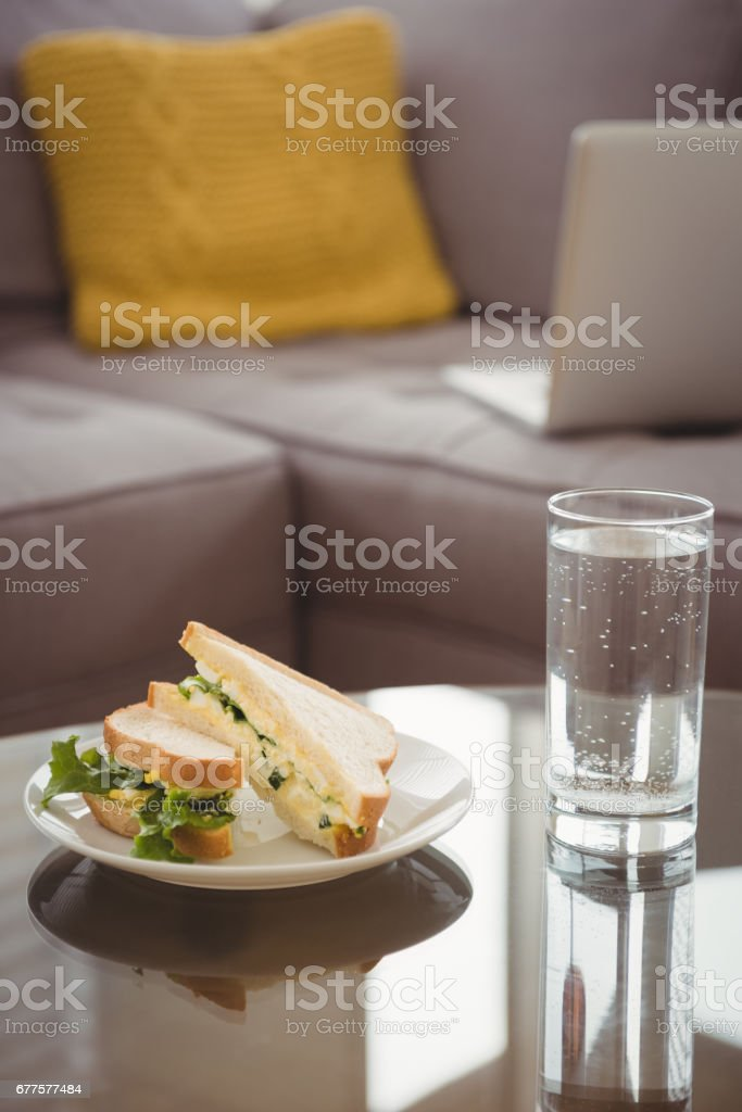 Close up of food in plate by drinking glass royalty-free stock photo