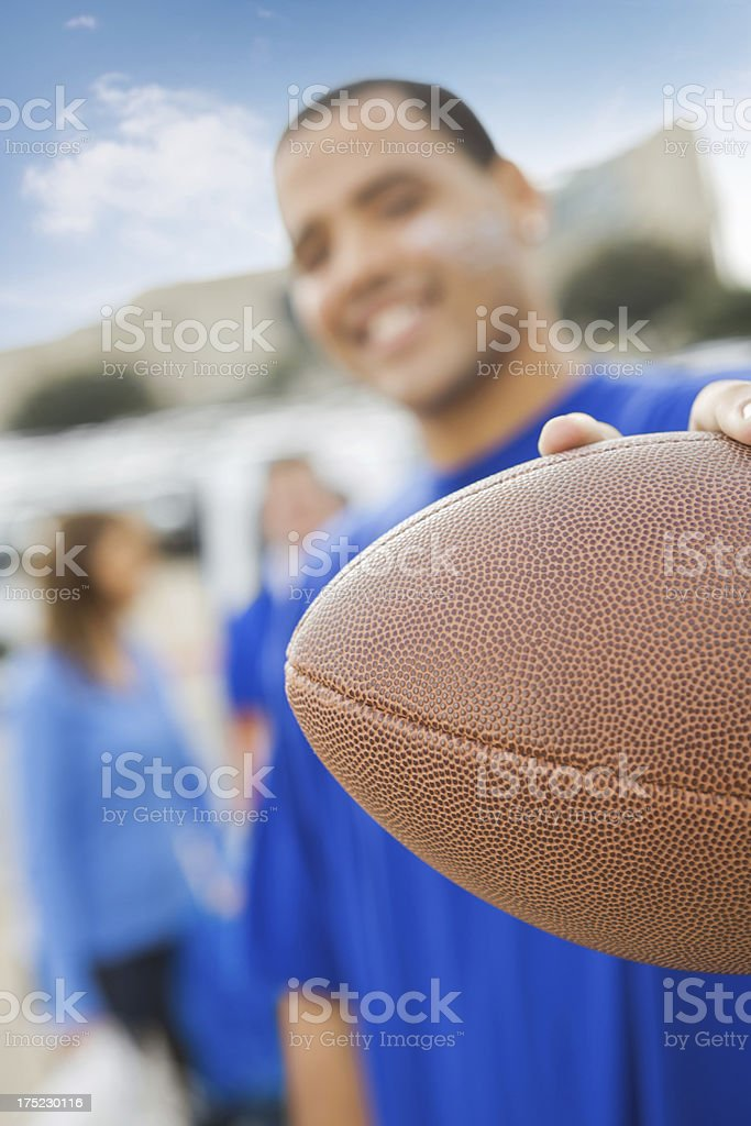 Close up of football, fan at stadium tailgate party royalty-free stock photo