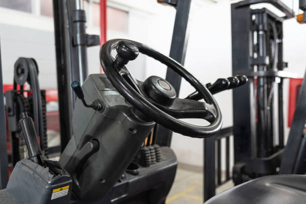 Close up of forklift steering wheel stock photo