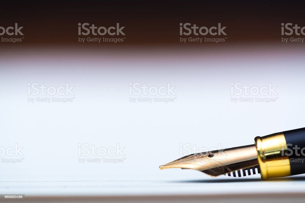 Close up of fountain pen or ink pen with notebook paper on wooden working table with copy space, office desk concept. shallow focus. - Royalty-free Accountancy Stock Photo