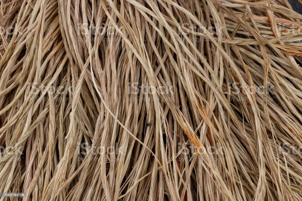 A close up of frayed strands from a natural fiber brown rope. stock photo