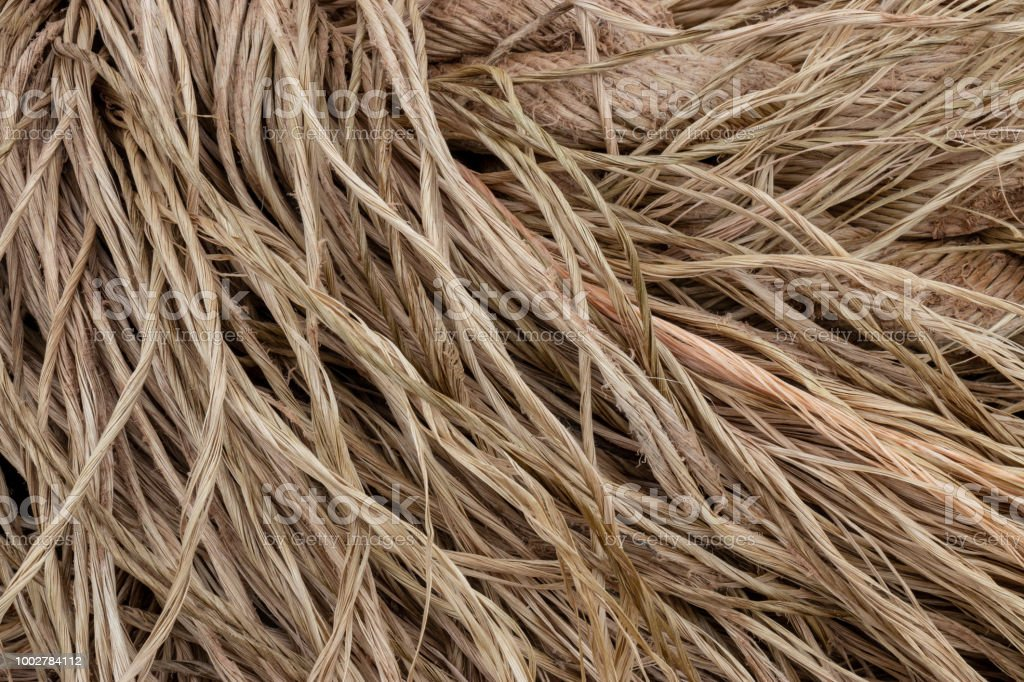 A close up of frayed strands of natural fiber brown rope. stock photo