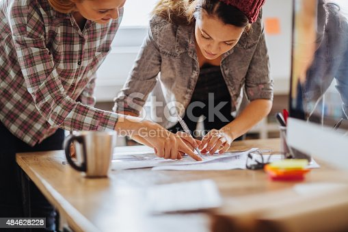 istock Close up of freelancers hands working by desk 484628228