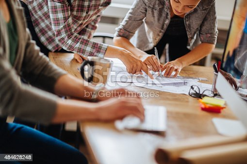 istock Close up of freelancers hands working by desk 484628248