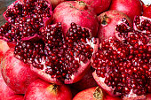 Close up of fresh harvested juicy pomegranate