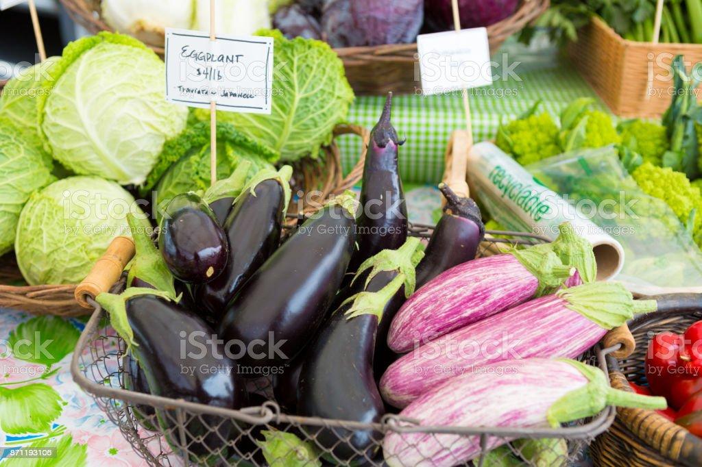 Close up of fresh organic eggplants at the farmers market stock photo