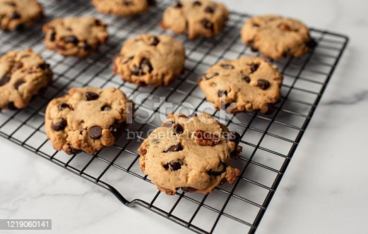 istock Close up of freshly baked chocolate chip cookies on cooling rack. 1219060141