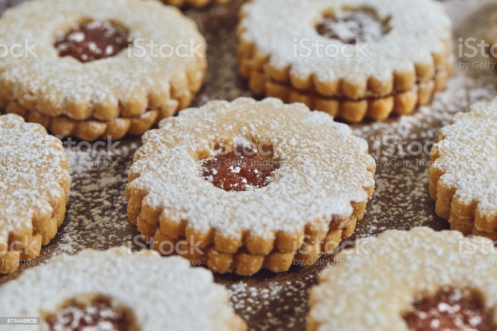 Close up of freshly baked homemade Christmas sugar cookies with jam stock photo