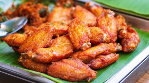 chicken wings on green plate