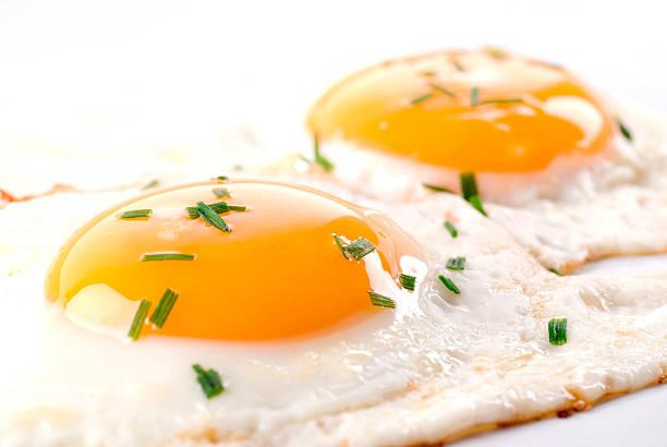 A close up of fried eggs with seasonings bildbanksfoto