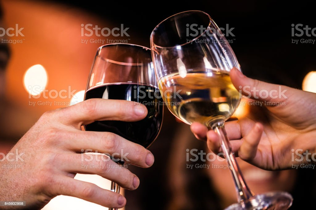 Close up of friends toasting with wine stock photo