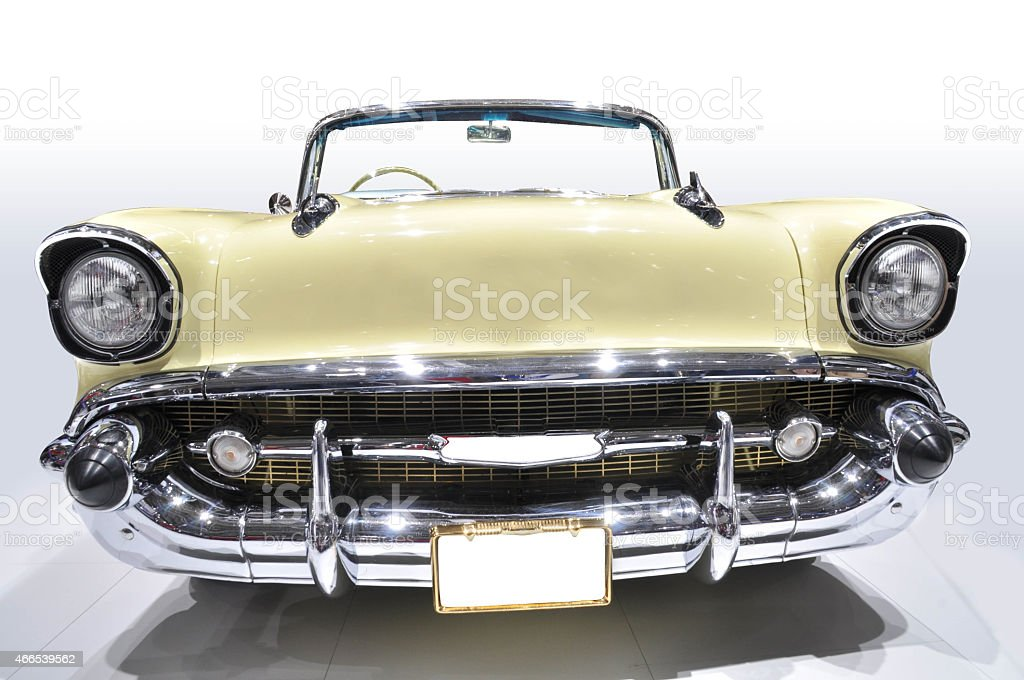 Close up of front of cream and chrome classic car stock photo
