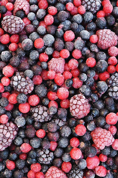close up of frozen mixed fruit  - berries - frozen berries stock photos and pictures