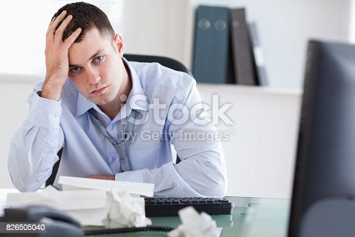690496350istockphoto Close up of frustrated businessman doing his accounting 826505040
