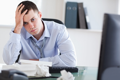 690496350 istock photo Close up of frustrated businessman doing his accounting 826505040