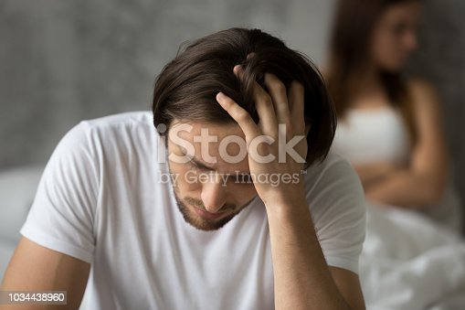 istock Close up of frustrated husband considering relationship problems 1034438960