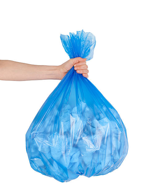 Close up of garbage bag holding by hand stock photo