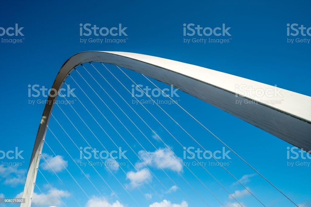 Close up of Gateshead Millennium Bridge, a pedestrian and cyclist tilt bridge spanning the River Tyne in Newcastle, England. stock photo