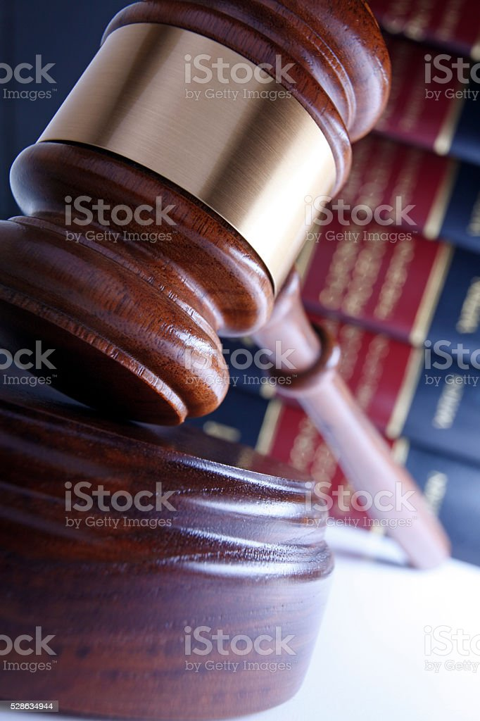 Close Up Of Gavel with Law Books In Background stock photo