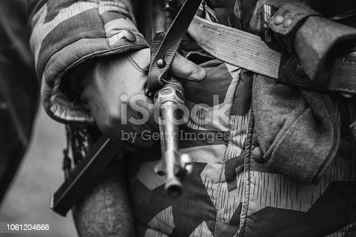 1061204700 istock photo Close Up Of German Military Ammunition Of A German Soldier. World War II German Soldier Holding Sub-machine Gun.Photo In Black And White Colors. 1061204666