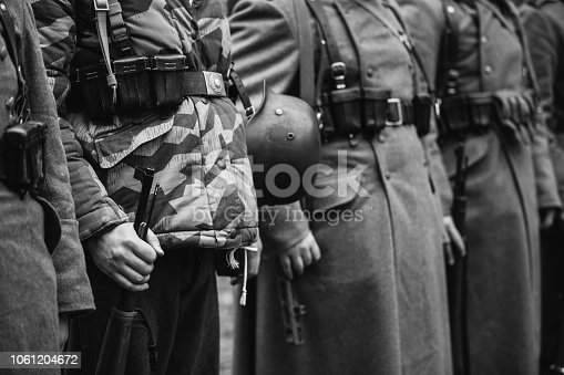 1061204700 istock photo Close Up Of German Military Ammunition Of A German Soldier. World War II German Soldiers Standing Order. Photo In Black And White Colors. Soldiers Holding Weapon Rifle 1061204672