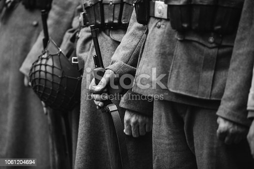 1061204700 istock photo Close Up Of German Military Ammunition Of A German Soldier. World War II German Soldiers Standing Order. Photo In Black And White Colors. Soldiers Holding Weapon Rifle 1061204694