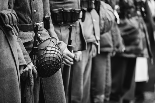 istock Close Up Of German Military Ammunition Of A German Soldier. World War II German Soldiers Standing Order. Photo In Black And White Colors. Soldiers Holding Weapon Rifle 1061204700
