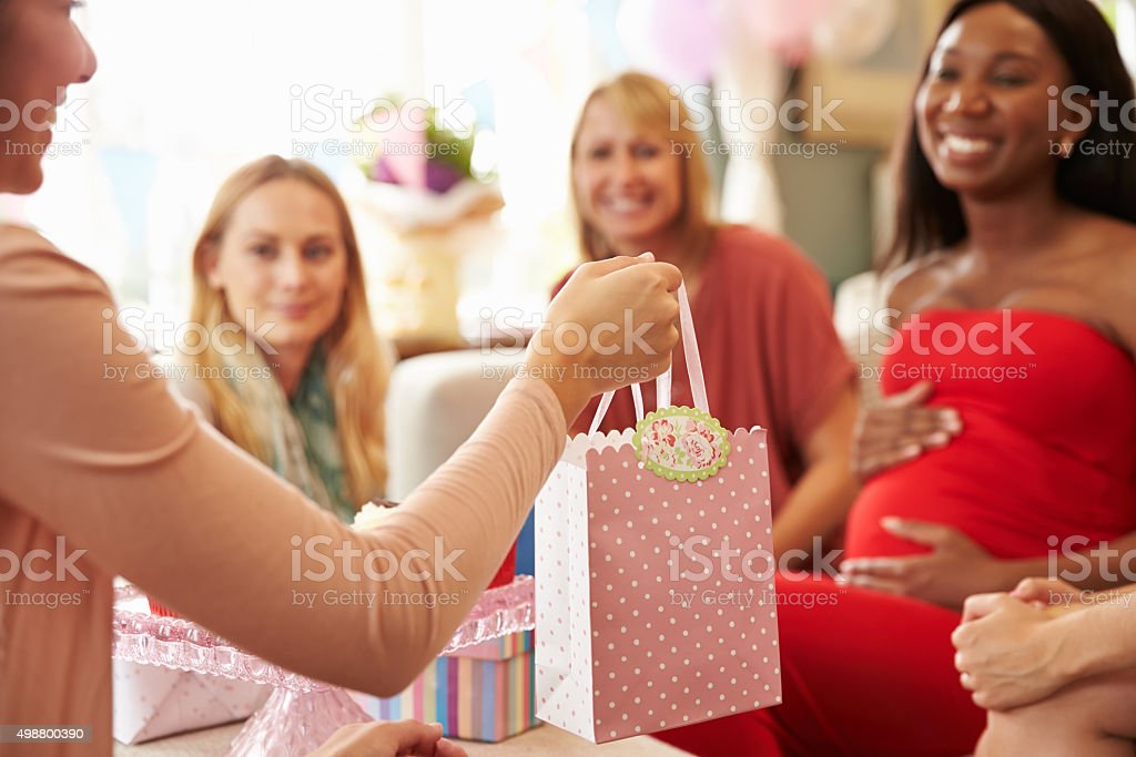 Close Up Of Gift For Pregnant Woman At Baby Shower stock photo