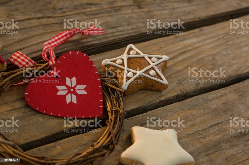 Close up of gingerbread cookies with Christmas decoration on table stock photo