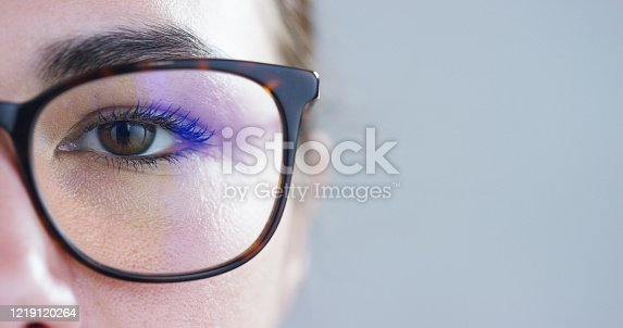 istock Close up of girl eyes wearing glasses and looking in the camera 1219120264