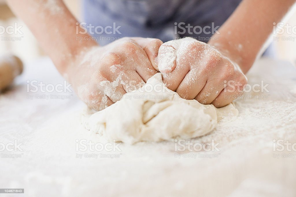 Close up of girl kneading dough stock photo