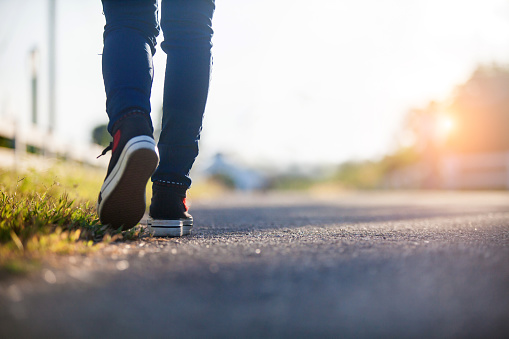 istock Close up of girl shoes walking 1131752071