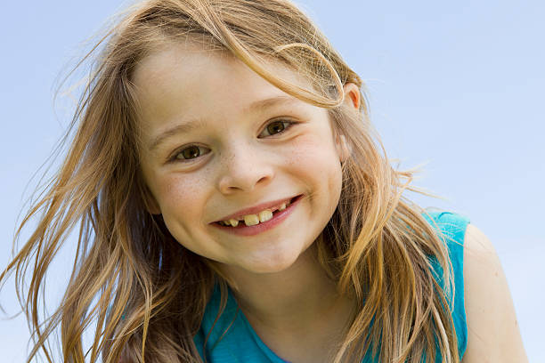 Close up of girls smiling face stock photo