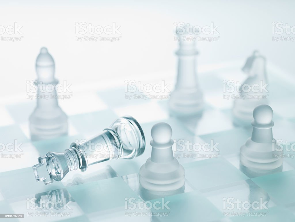 Close up of glass chess pieces stock photo