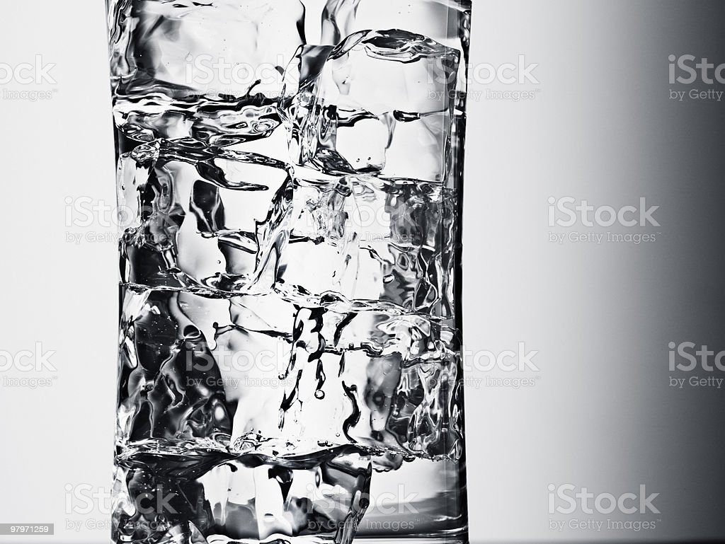 Close up of glass with ice cubes royalty-free stock photo