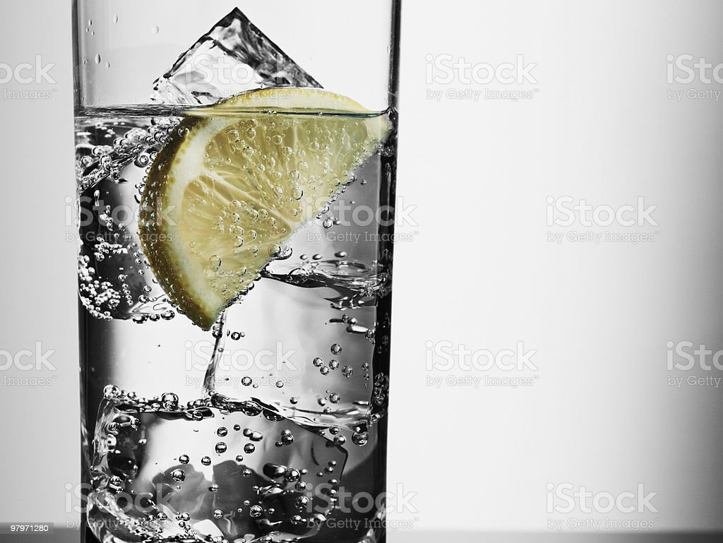 Close up of glass with water, ice cubes and lemon slice royalty-free stock photo
