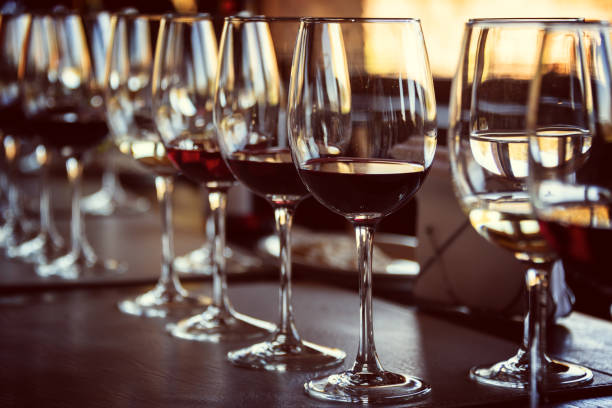 Close up of glasses of wine on a table during a wine tasting Close up of glasses of wine on a table during a wine tasting winetasting stock pictures, royalty-free photos & images