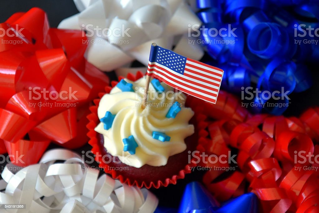 close up of glazed cupcakes decorated with american flag stock photo