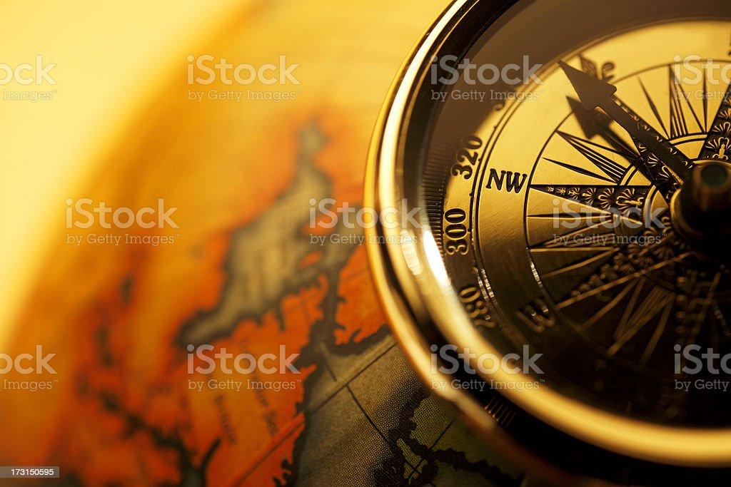 Close up of globe sitting on antique globe stock photo
