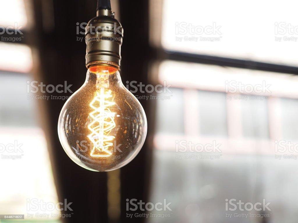 Close up of glowing modern light bulb stock photo
